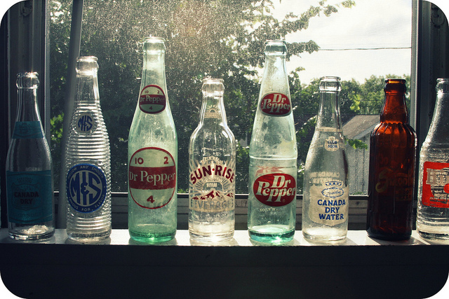 thrift store finds womanly advice soda pop bottles